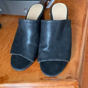 Black mules in mint condition